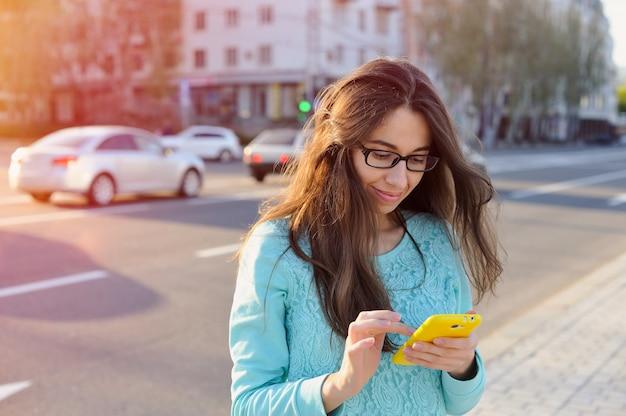 Beautiful young businesswoman write on smartphone Premium Photo