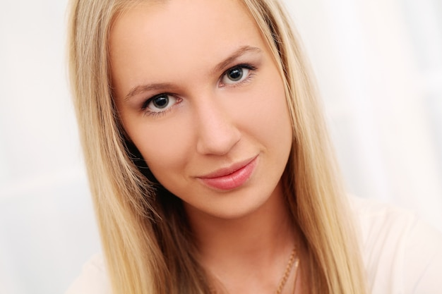 Beautiful young caucasian woman at home Free Photo