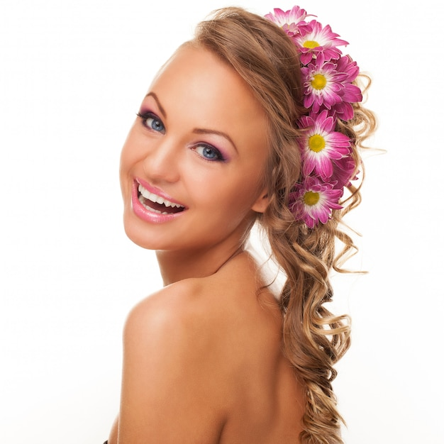 Beautiful young caucasian woman with flowers Free Photo