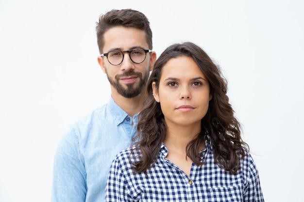 Beautiful young couple looking at camera Free Photo