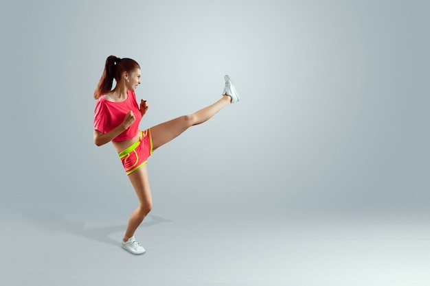 The beautiful, young girl beats a foot, goes in for sports. the concept of weight loss, sports training, diet, healthy eating Premium Photo