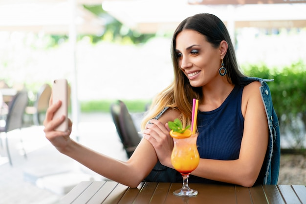 A beautiful young girl drinking an exotic summer cocktail Premium Photo