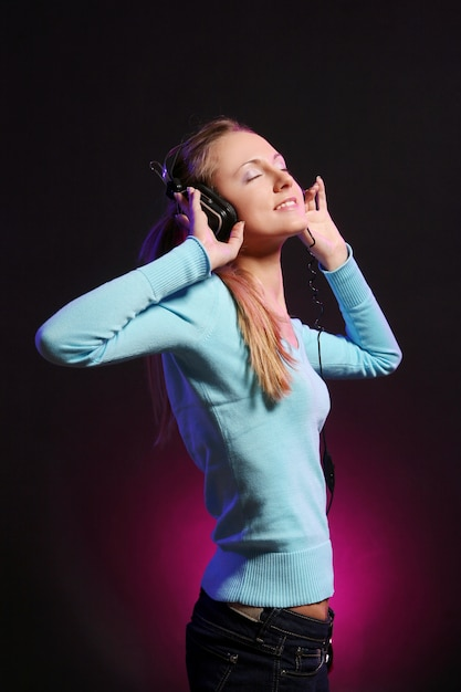 Beautiful young girl listen music Free Photo