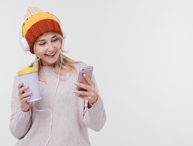 Beautiful young girl listening to music Free Photo