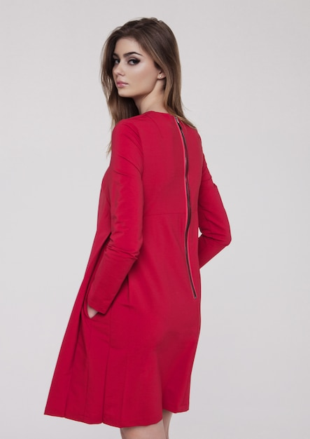 Beautiful young girl in red dress fashion Premium Photo