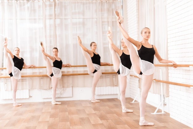 Beautiful young girls train in the hall for ballet. Premium Photo