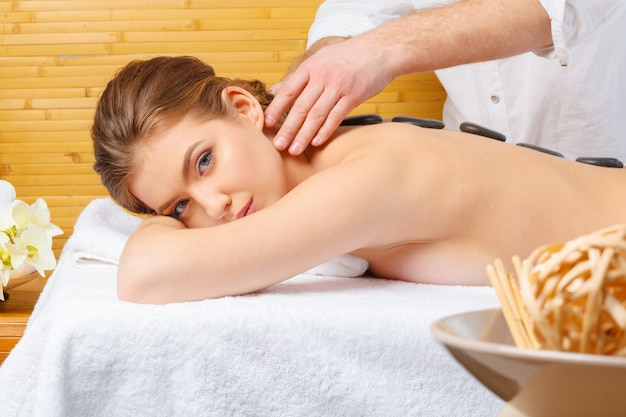 Beautiful, young and healthy woman in spa salon. massage treatment Premium Photo