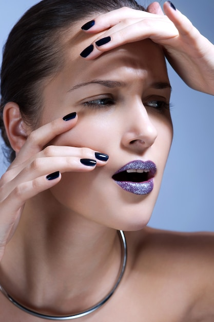 Beautiful young model with bright make-up and manicure Premium Photo