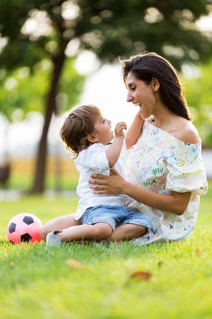 Beautiful Young Mother In Love With Her Son In The Park -9843