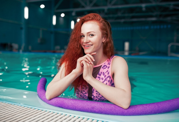 Beautiful young red-haired girl in a fashionable swimsuit Premium Photo