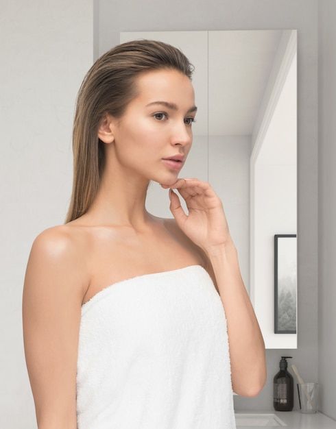 Beautiful young woman after shower Premium Photo