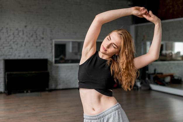 Beautiful young woman dancing in the studio Free Photo