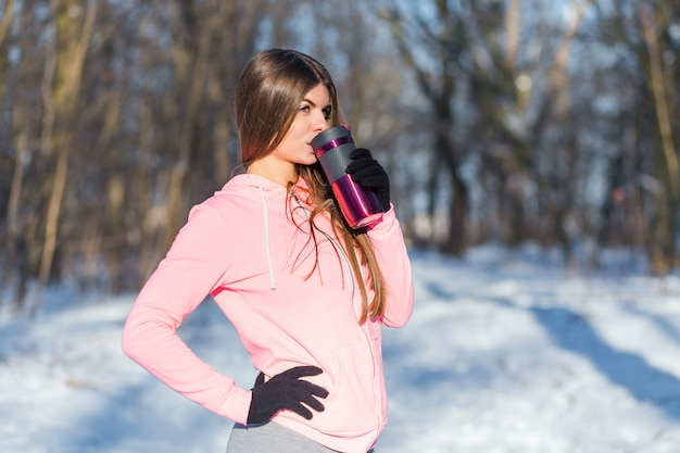 Beautiful young woman drinks tea Premium Photo