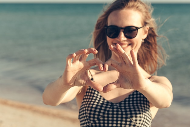 Beautiful young woman enjoy summer vacation on the beach Premium Photo