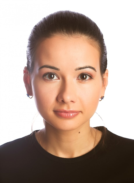 Beautiful young woman face. isolated over white Premium Photo