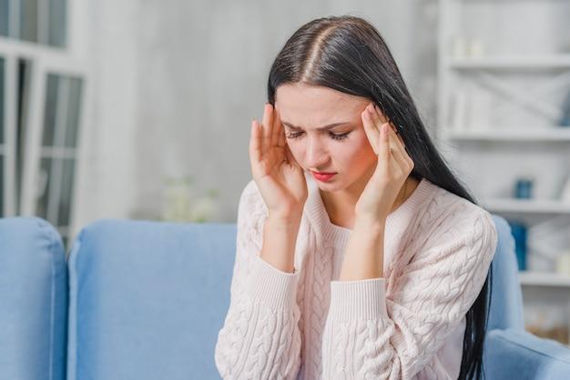 Beautiful young woman having headache Free Photo