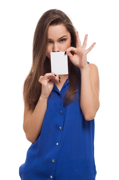 Beautiful young woman holds blank card Free Photo