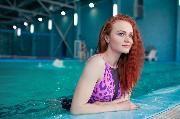 Beautiful young woman in the indoor swimming pool. athletic sexy girl. healthy lifestyle Premium Photo