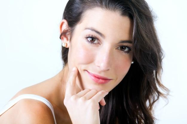 Beautiful young woman looking at camera Free Photo