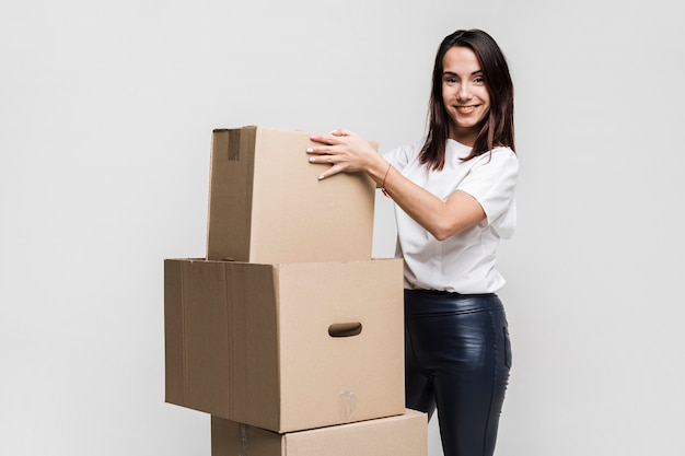 Beautiful young woman preparing moving boxes Free Photo