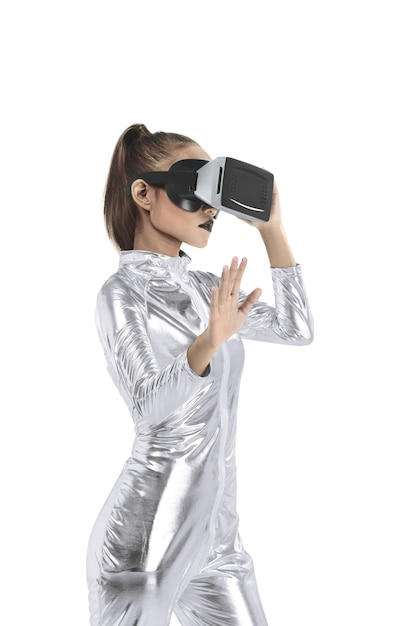 Beautiful young woman in silver latex costume and vr headset Premium Photo