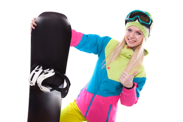 Beautiful young woman in ski outfit and ski glasses hold snowboard Premium Photo