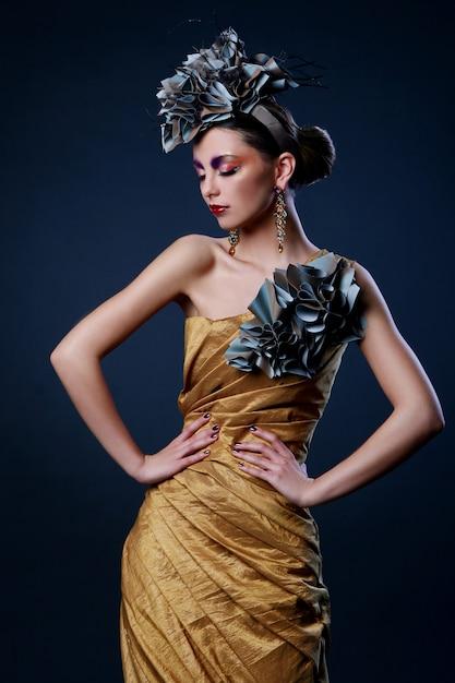 Beautiful young woman in stylish dress Free Photo