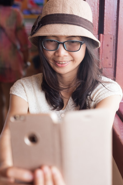 Beautiful young woman taking selfie. Premium Photo