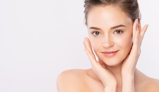 Premium Photo | Beautiful young woman touching her clean face with fresh  healthy skin, isolated on white