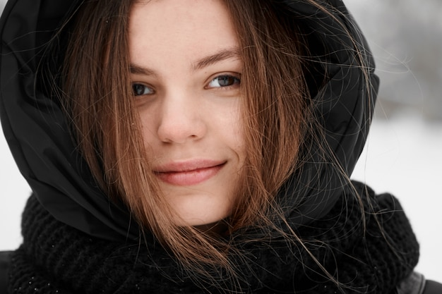 Beautiful young woman winter outdoor portrait close up Premium Photo