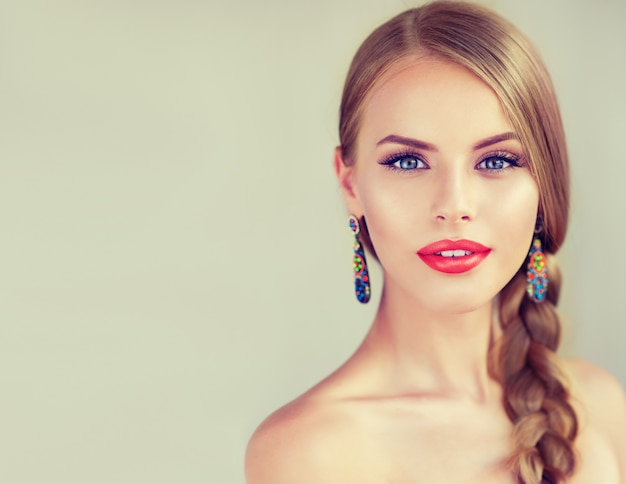 Beautiful young woman  with braid and red lips Premium Photo