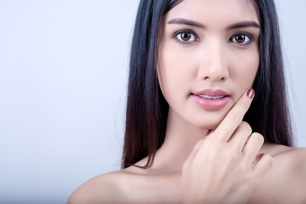 Beautiful young woman with clean fresh skin look away Premium Photo