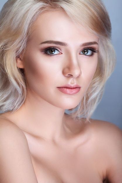 Beautiful young woman with clean fresh skin touch own face , facial treatment , cosmetology , beauty and spa , Premium Photo