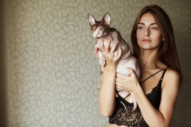 Beautiful Young Woman With Cute Cat Resting At Home Premium Photo