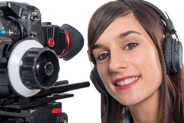 Beautiful young woman with dslr video camera Premium Photo