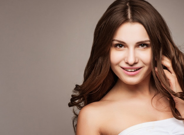 Beautiful young woman with hair flying Premium Photo