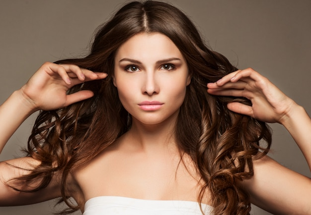 Beautiful young woman with long hair Premium Photo