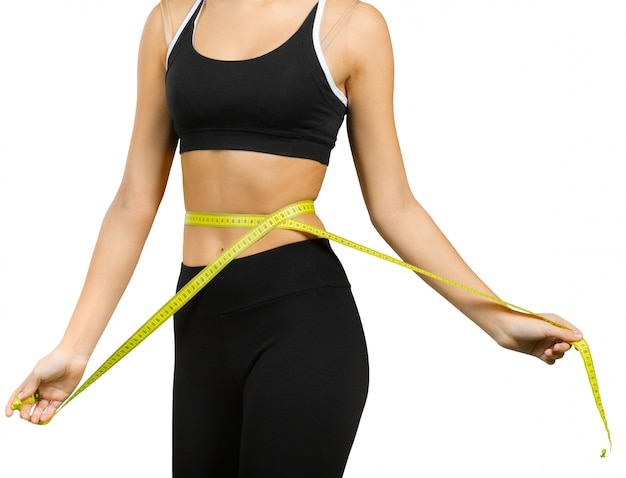 Beautiful young woman with measuring tape Premium Photo