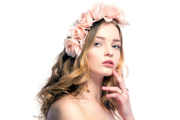 Beautiful young woman with pink flowers on head Premium Photo