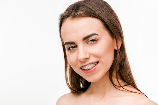 Beautiful young woman with teeth braces Free Photo