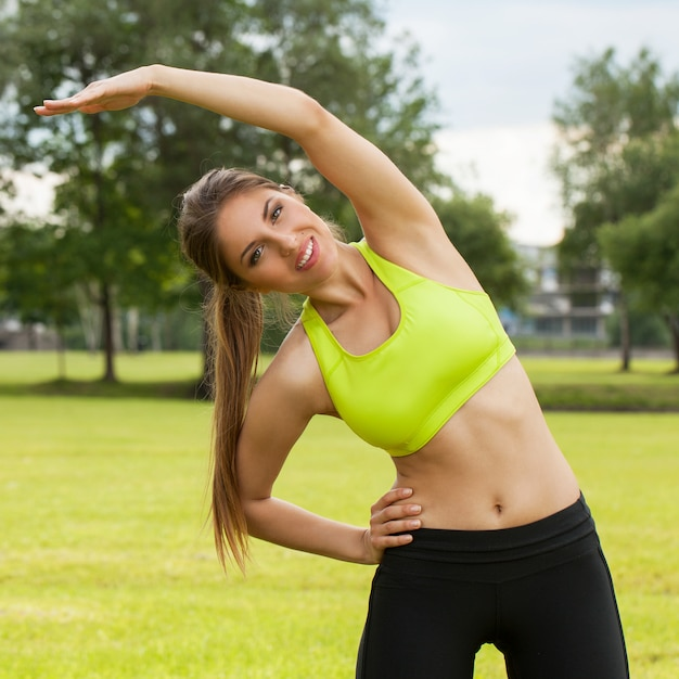 Beautiful young woman working out in a park Free Photo