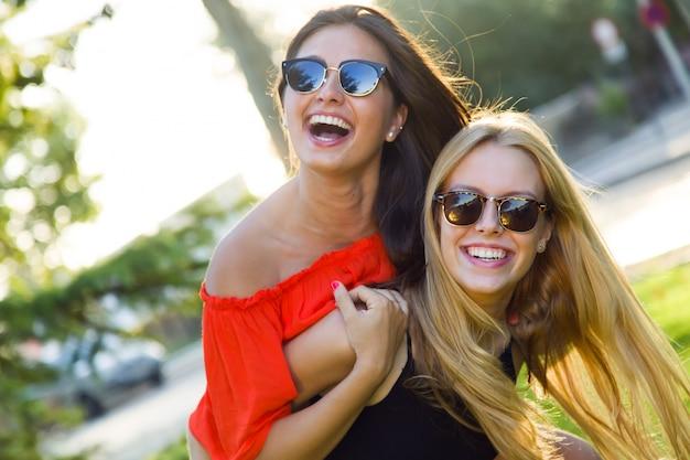 Beautiful young women having fun at the park. Free Photo