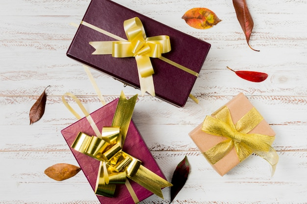 Beautifully decorated present boxed on wooden panel Free Photo