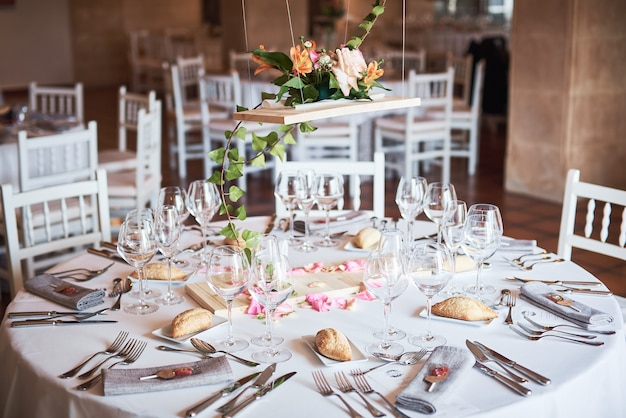 Beautifully decorated tables for guests with decorations in a restaurant. Premium Photo