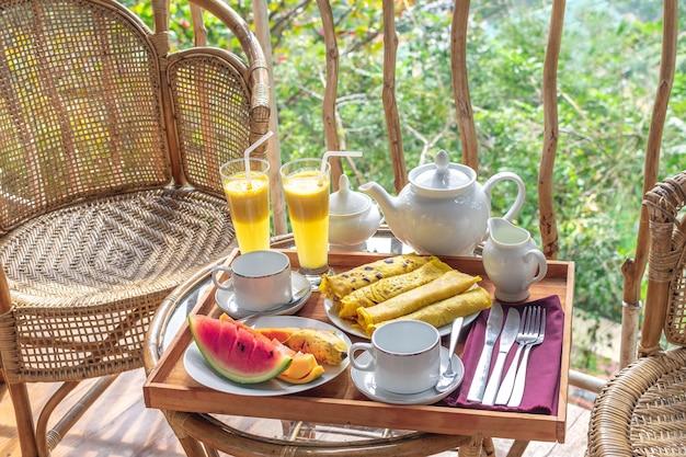 Beautifully served breakfast on terrace or balcony Premium Photo