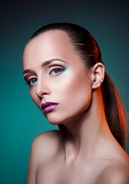 2b14caf5f77 Beauty art makeup on face of a woman big blue eyes Photo | Premium ...