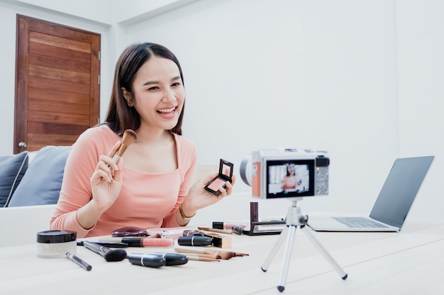 Premium Photo | Beauty bloggers, beautiful asian women are trying to  understand and sell cosmetics. via online streaming by using a camera and  laptop with a happy smiling face, a new normal