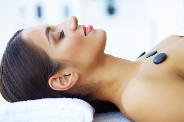 Beauty and care. beautiful young girl with mask in spa salon. spa therapy. Premium Photo