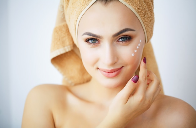 Beauty and care, portrait of a girl with a brown towel on the head, Premium Photo