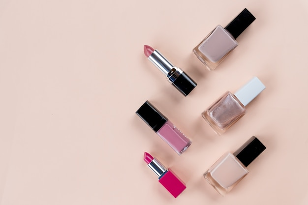 Beauty concept. set of professional makeup cosmetic on pastel background. cosmetics set. decorative cosmetics objects, nail bottles, lipstick.copy space Premium Photo